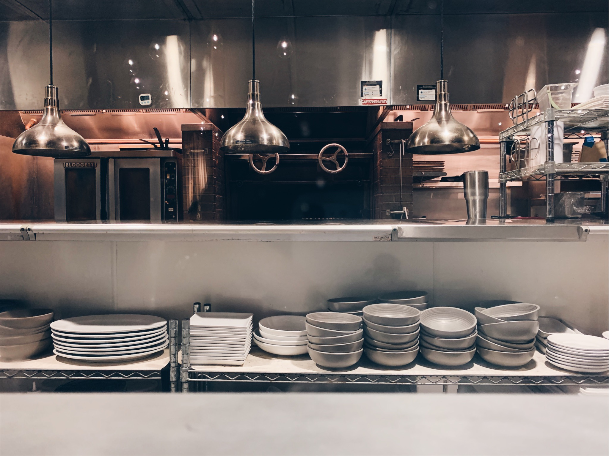 Equipment and plating areas in back-of-house kitchen interior