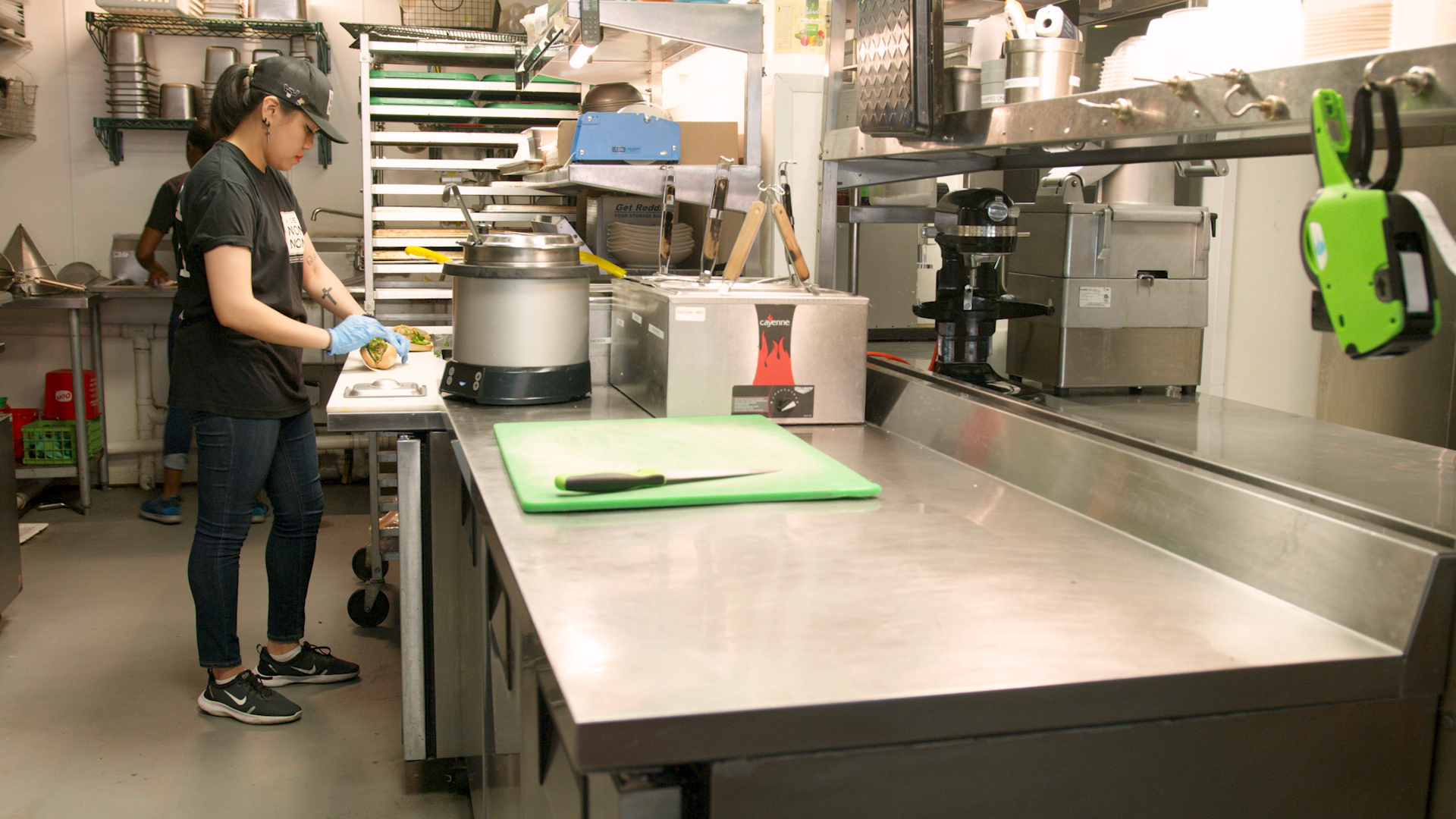 Staff in working in back-of-house prep kitchen in a quick service restaurant