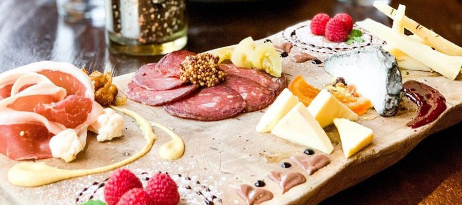 The Iberian Pig Buckhead Charcuterie Tasting Board